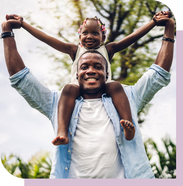 a little girl sitting on a man's shoulders